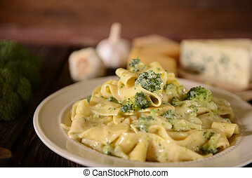 Pappardelle pasta with four cheese sauce and broccoli