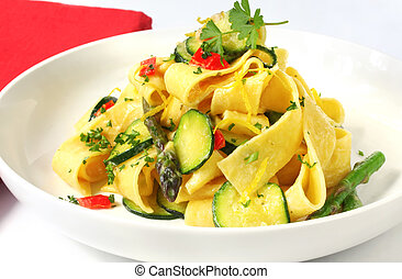 Pappardelle (wide ribbon pasta) with courgette and asparagus and a creamy sauce.