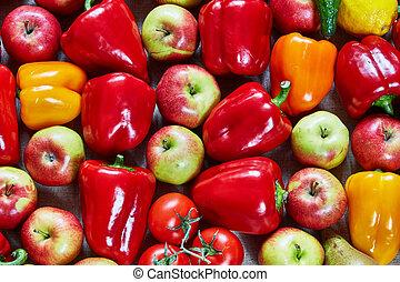 Paprika, apple, citrus, tomato, cucumber, pear lies on a canvas