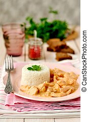 Chicken stroganoff with paprika sour cream sauce and rice