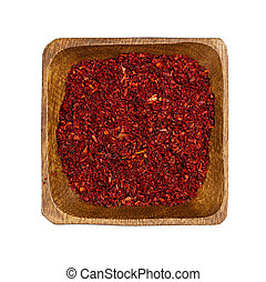 Paprika in wooden bowl isolated on white