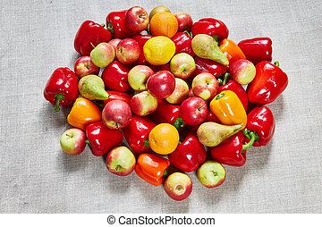Paprika, orange, pear, apple on a gray canvas