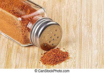 Paprika Pepper Shaker on a wooden background - Pepper shaker...