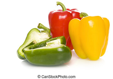 paprika - three fresh and healthy paprikas on a white...