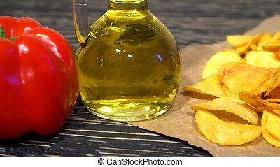 Paprika potato chips dolly with oil, potato and paprika.
