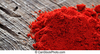 Paprika powder close up, on a wooden table, copy space