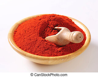 Paprika powder in a wooden bowl