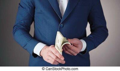 paquet, vidéo, bleu, homme affaires, dollars, veste