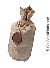 paquete, envuelto, con, un, sello de lacrar