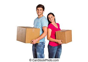 par, caixas, segurando, em movimento, jovem
