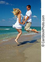 par feliz, pular, praia