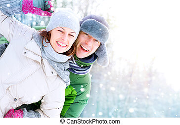 par feliz, tendo divertimento, outdoors., snow., férias inverno