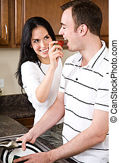 par jovem, cozinha