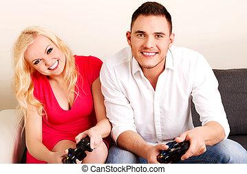 par, jovem, jogos video, tocando, feliz