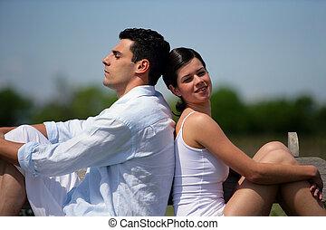 par, sol, jovem, sentando