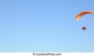 Para motor glider on blue sky