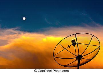 Parabolic satellite dish in twilight with moon