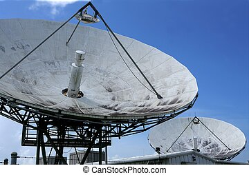 Parabolic satellite dish receiver over blue sky - Parabolic ...