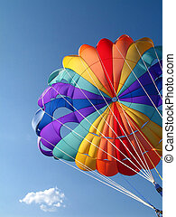 Parachute - A colorful parachute with blue summer sky in the...