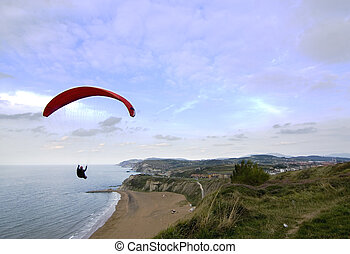 people having fun flying in the sky with parachute