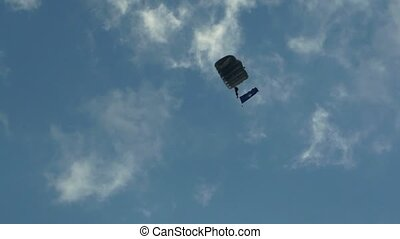 Parachutist 002 - Parachutist against blue sky with clouds....