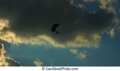 Parachutist 004 - Parachutist against blue sky with clouds....