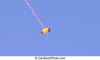 Parachutist - A jumper soars in the air