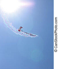 parachutist against the sun