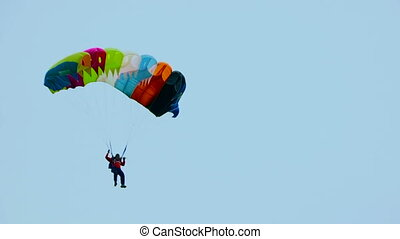 Parachutist in the sky