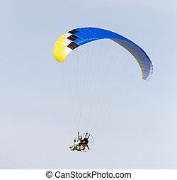 parachutist in the sky