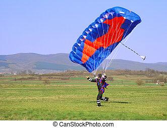 Parachutist running