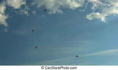 Parachutists 001 - Parachutist against blue sky.
