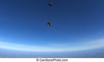 Parachutists Jumping in Tandem out of an Airplane....