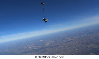 Parachutists Jumping in Tandem out of an Airplane. Slow...