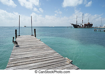 Paradise landscape of caribbean sea and wood pier
