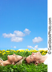 Paradise - Young love couple sleeping on green grass