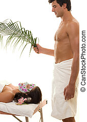 Paradise Spa - Relax and recharge. A woman receives...