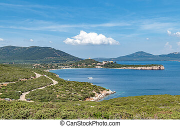 Paradisiac view above the sea shore in Sardinia with perfect blue water