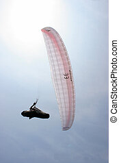 paraglider against the sun