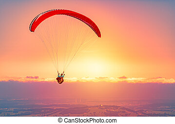 Paraglider at sunset in Germany, Europe