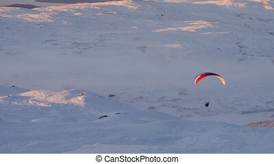 Paraglider fly in mountains