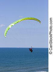 Paraglider flying above Mediterrane