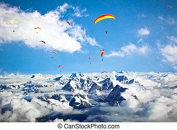 Paraglider flying against the Himalayas-Everest region,...