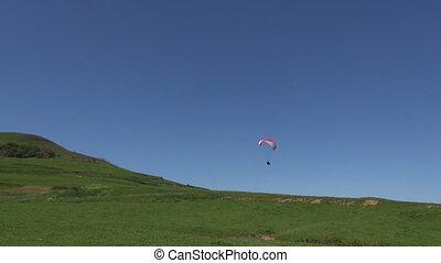 paraglider flying Asturias coast - paraglider flying over...