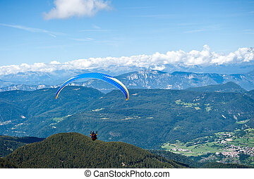 Paraglider flying over the Italian Alps