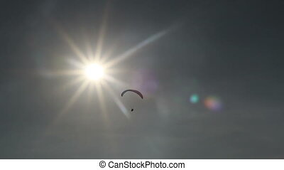 paraglider flying to sun - paraglider flying towards the sun