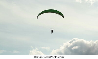 Paraglider in cloudly sky - Paraglider fly in cloudly sky