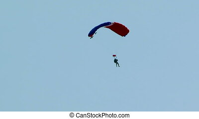 Paraglider in the sky - Paraglider flying high in the sky