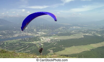 Paraglider launching 01 - Paragliding high above the...