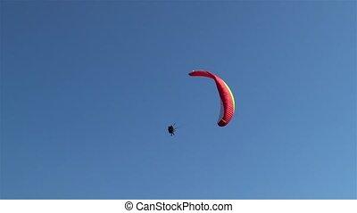 Paraglider flies by the Harder Kulm observation deck, Interlaken, Switzerland.